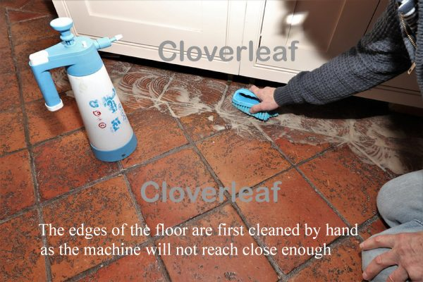 Cleaning Terracotta floor with brush